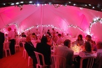 Capri Marquees showing fairy lights and ivy decoration with uplighters at night